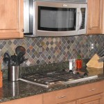 slate back splash with metal tile accent