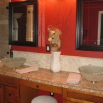 granite counter top tile installed on ditra custom tumbled travertine back splash glass tile
