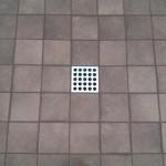 glazed porcelain shower floor tile Ebbe drain tampa orlando florida