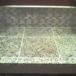 Granite Tile Counter with a Travertine & Glass Splash Tampa Orlando Sarasota Brandon Bradenton Florida