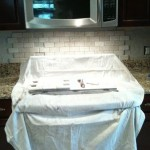 2x4 Tumbled Brick Chiaro Travertine backsplash installation Tampa Sarasota Brandon Bradenton St Pete Clearwater Florida