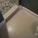 Pebble Shower & Plank Tile Bathroom tampa st petersburg st pete sarasota brandon brandenton largo tile installation