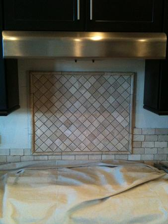 Ceramictec 2 4 tumbled travertine back splash with glass tile accents for Tumbled glass tile